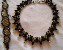 Black and gold necklace with matching bracelet